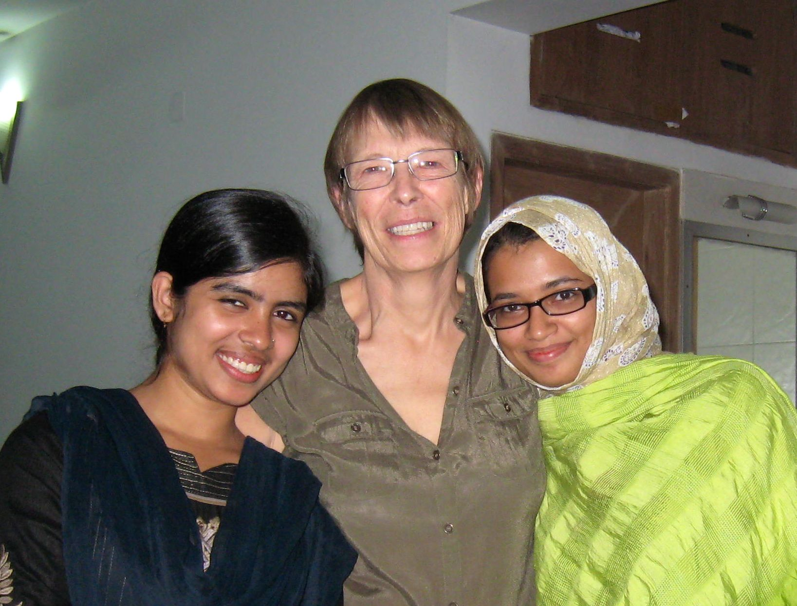 Professor of Biology Jinnie Garrett, center, with students at the Asian University for Women.