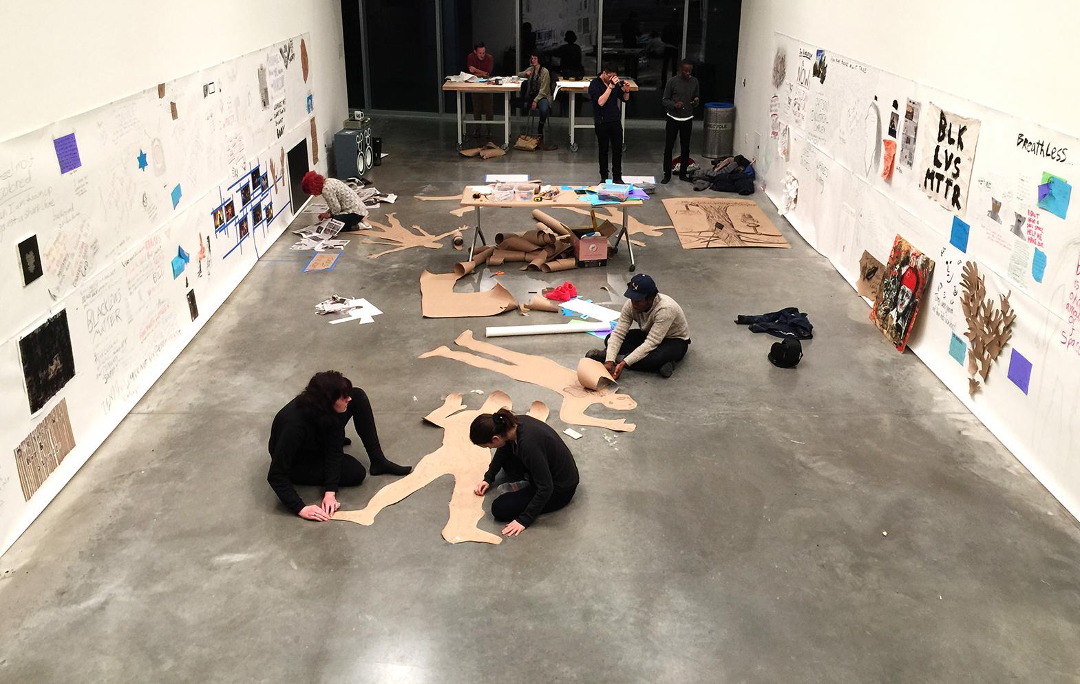 Students work on their installation.