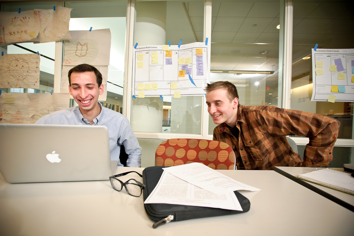 Matias Wolansky '16, left and Nick Pappageorge '14 work on their project during the Levitt Social Innovation Fellows Program.