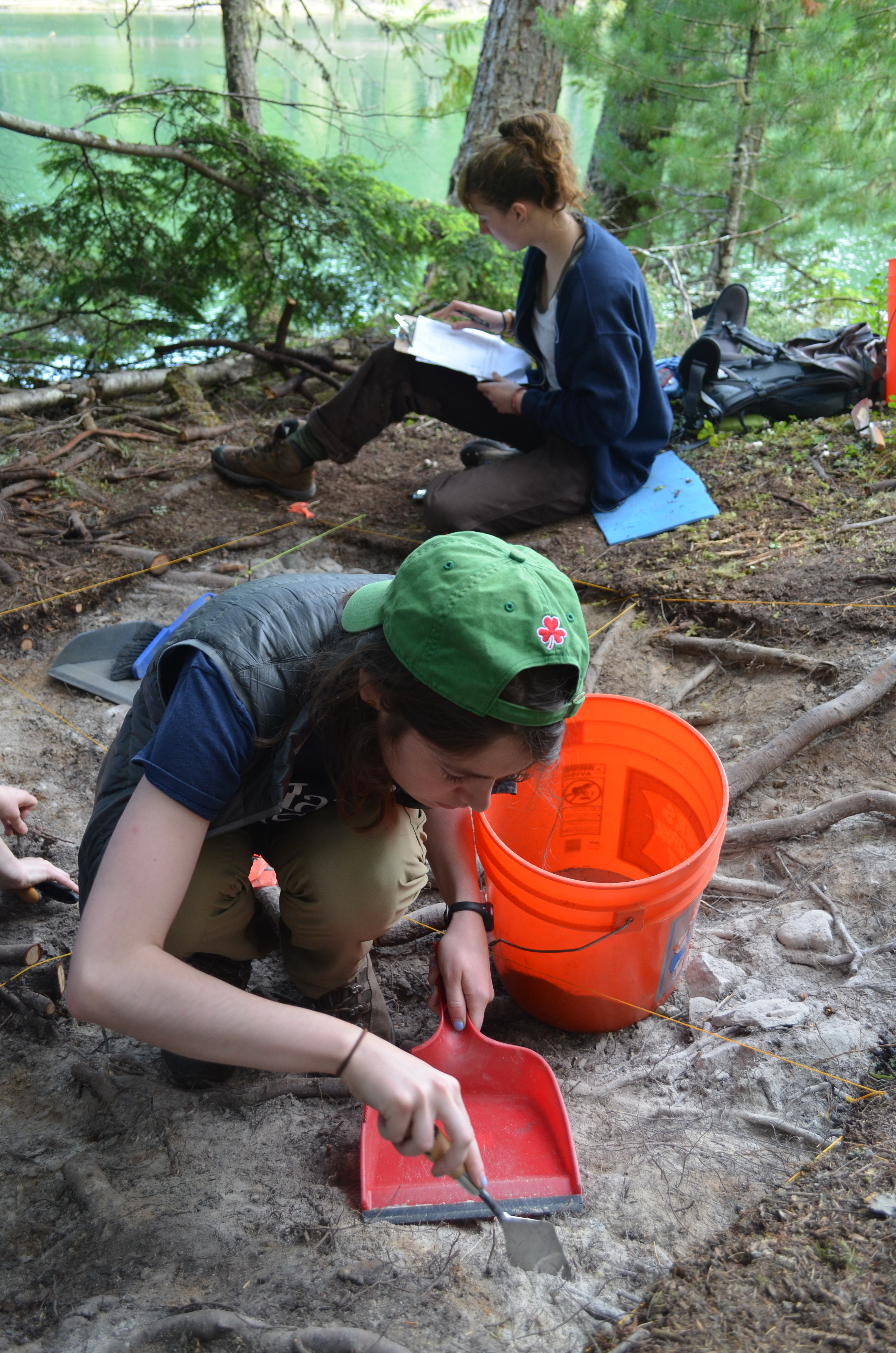 In front, Lindsay Buff '17 at work at the Slocan Narrows Archaeological Project during Hamilton's summer field school.