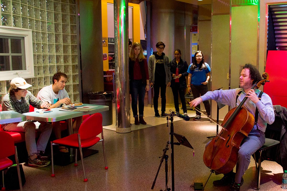 Cellist Matt Haimovitz performs outside the Diner on Friday, Nov. 6.