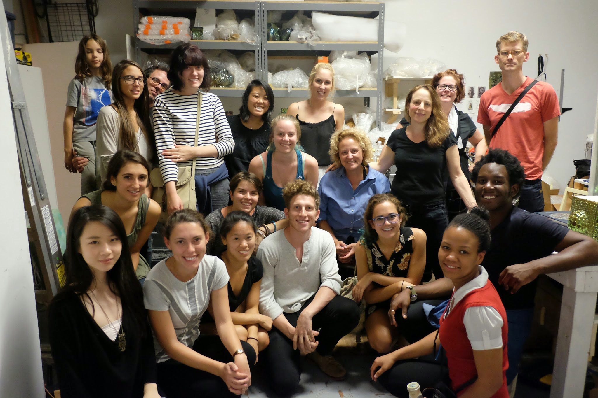 Hamilton senior art concentrators and faculty visit the studio of sculptor Julia Kunin, right center, in black.
