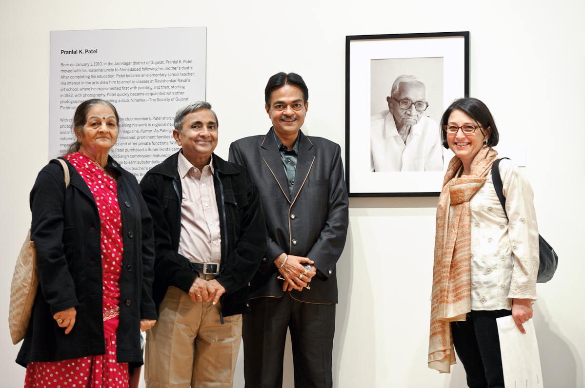 Anand Patel, with his wife Jaya, left, and son Gautam, right, pose with Lisa Trivedi and a portrait of Pranlal Pratel, whose work is on exhibit at the Wellin Museum of Art.