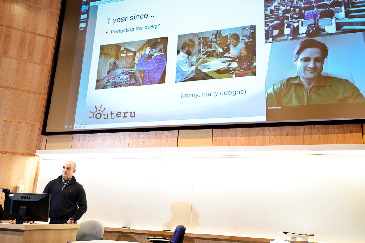 Kevin Bourque '05, left, and Joshua Kunkel '04, on screen, co-founders of Face Glove and winners of the 2012 Hamilton Pitch Competition, give a presentation on preparing for the pitch competition.