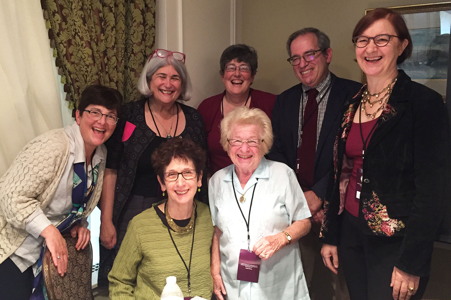 Professor Rabinowitz and Ruth Westheimer (Dr. Ruth), front, with CAAS panel members.