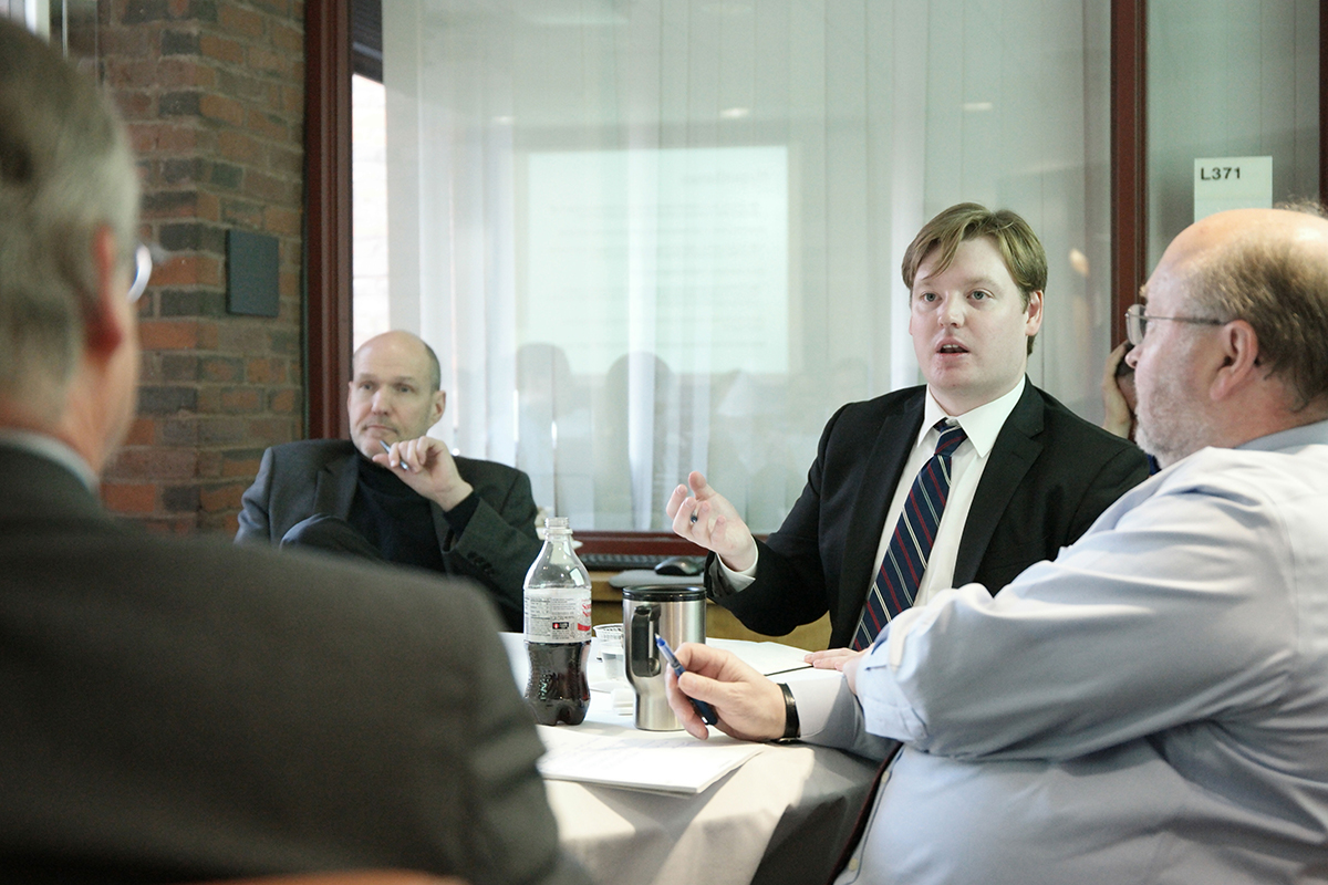 Visiting Assistant Professor of Government Ivan Rasmussen (center) discusses Chinese foreign policy with Stephen Walt (left) and Steven Miller (right).