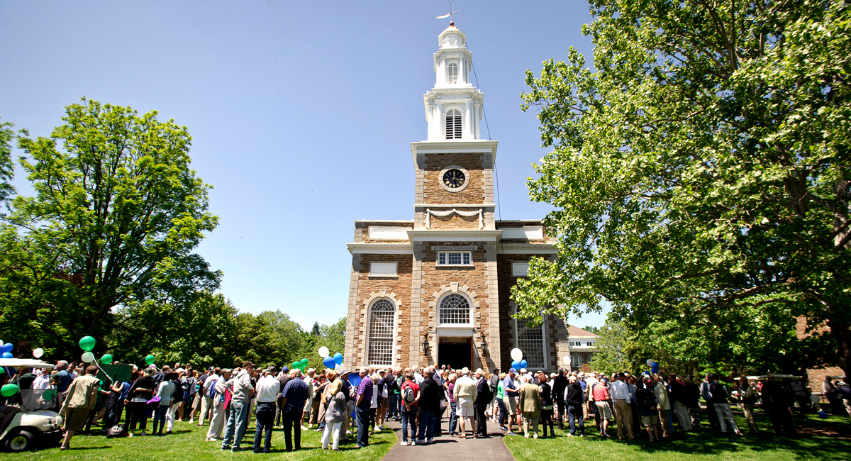 Alumni gather outside the Chapel after the parade.
