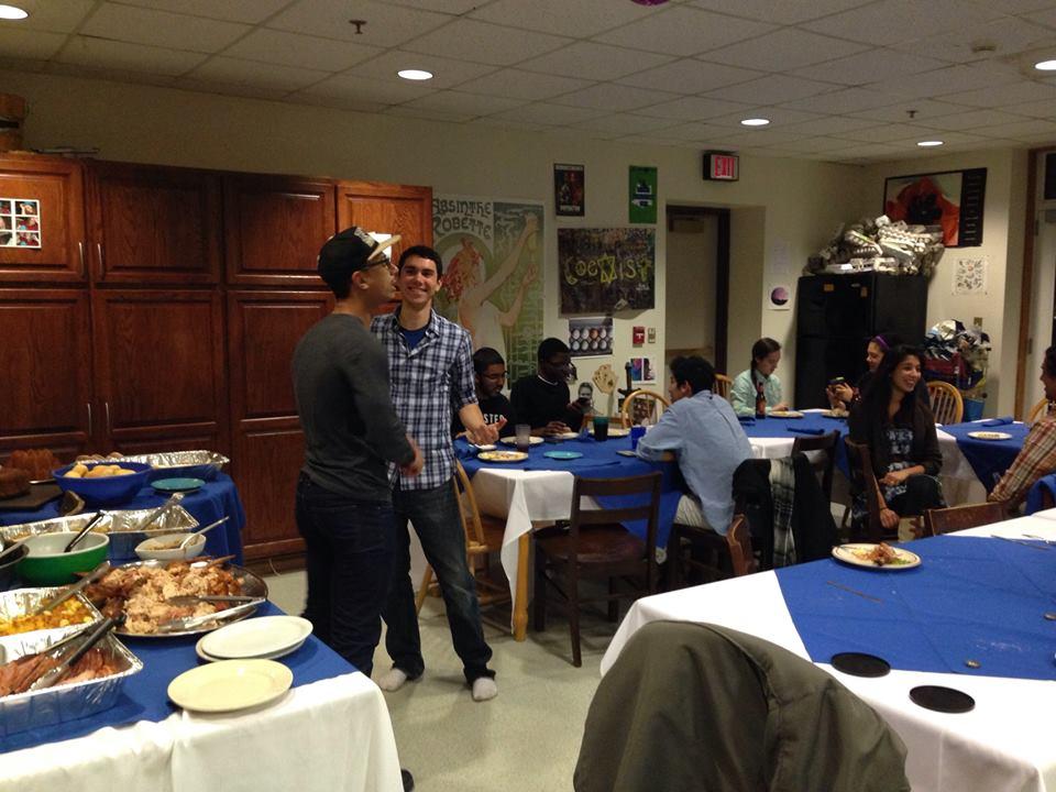 Students chat over Thanksgiving dinner in Woollcott House.