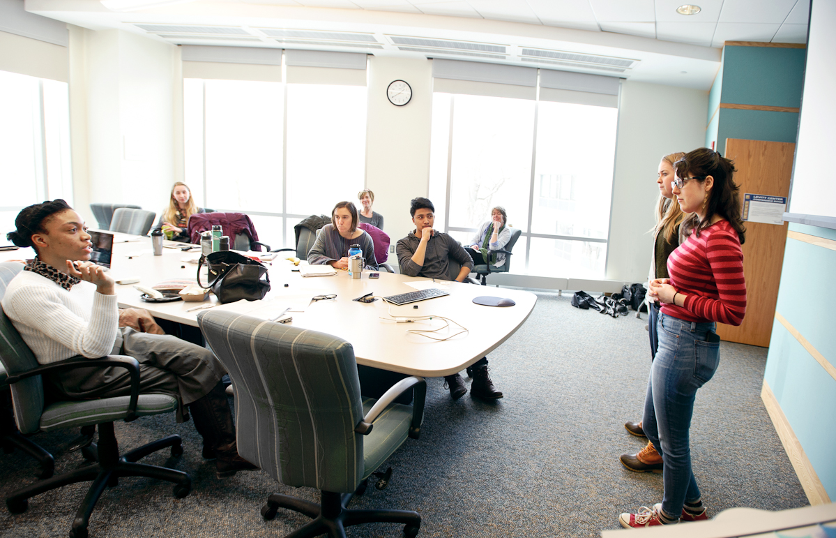 Meghan O'Sullivan '15 and Alicia Rost '15 discuss their non-profit business idea with the group.