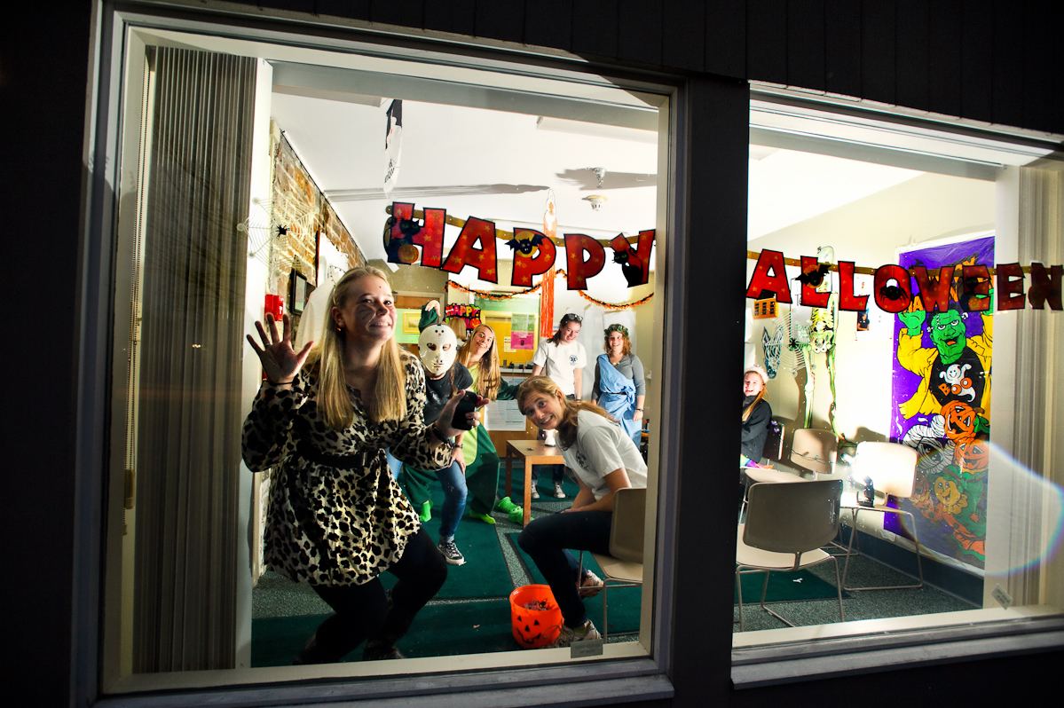 Katie Callahan '15, hangs out in the window of the the Health Center trying to entice trick or treaters during Trust Treat.