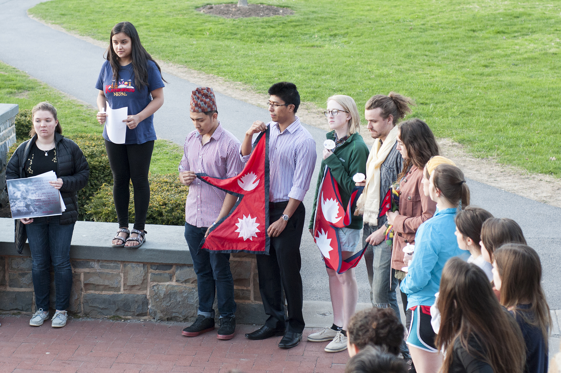 Nepali student Priti Kharel '18 addresses the crowd in front of Commons.