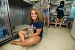 Katie Moran &apos;15 spends quality time with &quot;Fluffy&quot; at the Rome Humane Society in Rome, N.Y.<br />Photo: Nancy Ford